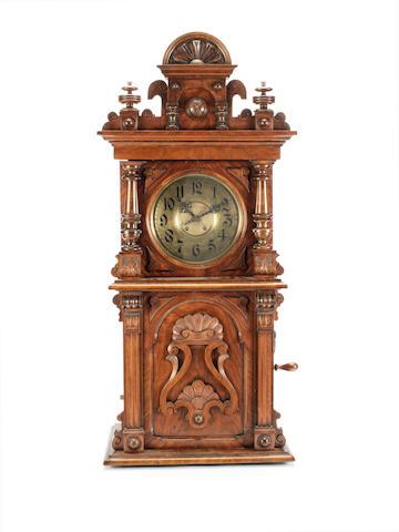 An 11.5/8-inch Symphonion disc musical wall clock, circa 1900,