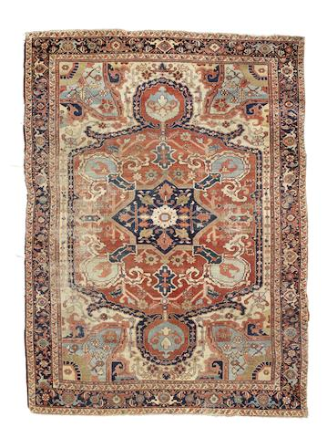A Heriz carpet, North West Persia, circa 1900, 11 ft 9 in x 8 ft 6 in (359 x 260 cm) wear, minor areas of crude restoration