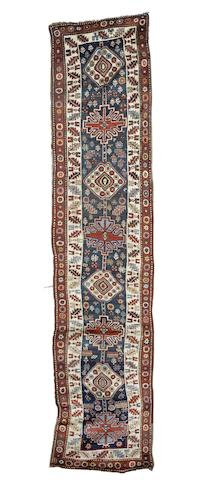 A Kazak runner, Central Caucasus, circa 1910, 15 ft 5 in x 3 ft 4 in (470 x 102 cm) some wear