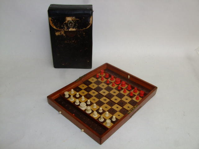 "An ""In Statu Quo"" travelling chess set, Jaques London, late 19th century,"