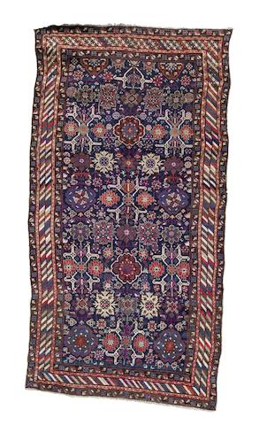 A Kuba rug, East Caucasus, circa 1910, 11 ft 5 in x 6 ft (347 x 184 cm) some restoration