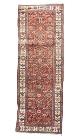 A Sultanabad khelleh, West Persia, circa 1890, 11 ft 5 in x 4 ft 1 in (349 x 125 cm) some wear, selvedges rebound