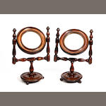 A small pair of turned stained beech shaving or toilet mirrors