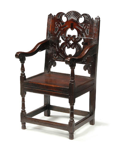 An extremely rare Charles II oak boarded-back open armchair North-West, Manchester, circa 1660