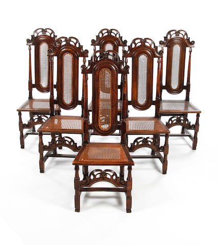 A set of six early 18th century walnut and cane high back chairsCirca 1710-20
