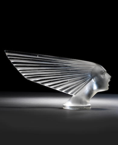 A 'Victoire' white glass mascot by René Lalique, French, first introduced 18th April 1928,