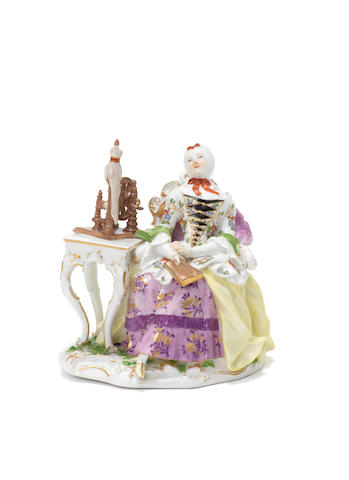 A Meissen figure of a lady at a spinning wheel, circa 1760