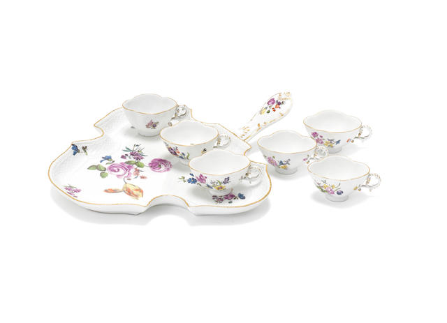 A Meissen tray with six cups, circa 1750-60