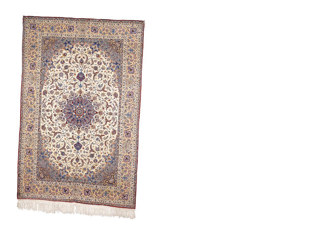 An Isfahan carpet, Central Persia, circa 1950, 10 ft 7 in x 6 ft 9 in (321 x 206 cm)