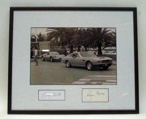 A framed Monochrome image of Roger Moore in the Aston Martin from 'The Persuaders',