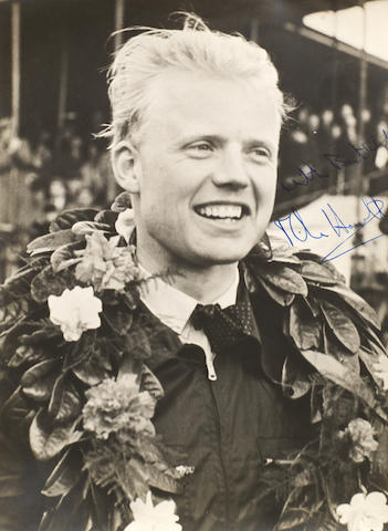 Autographed photographs of Stirling Moss and Mike Hawthorn.