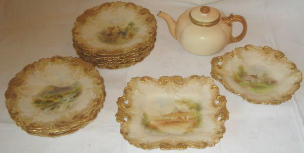 A Grainger & Co Worcester part dessert service, each pieces with leaf scrolling gilt border and centrally painted with a different rural titled scene, on a blush ivory ground, comprising: square shaped dish, 25 x 21cm, circular shaped dish, 20cm, ten dessert plates, 22cm, and a Royal Worcester blush ivory and gilt teapot and cover, puce marks 1892.