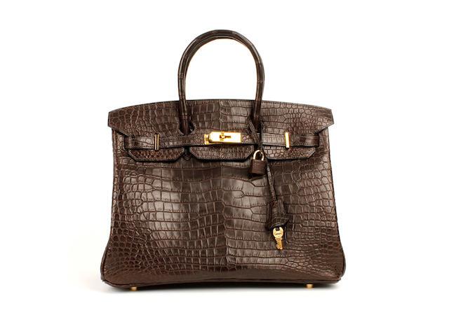 An Hermès dark brown matt crocodile Birkin bag, 2003