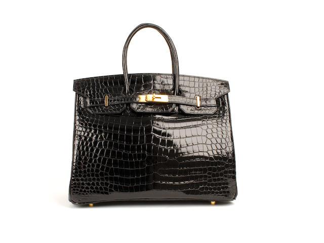 An Hermès black patent crocodile Birkin bag, 2003