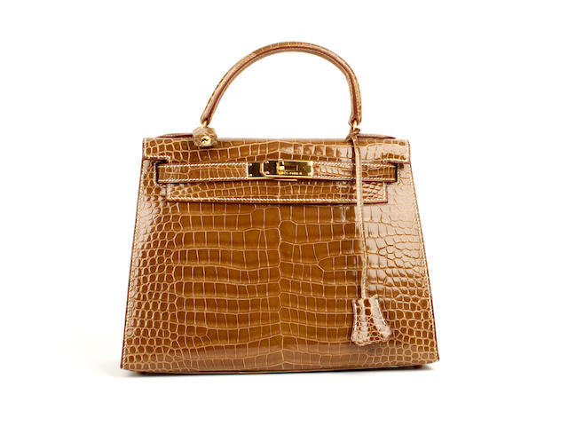 An Hermès light brown patent crocodile Kelly bag, 2003