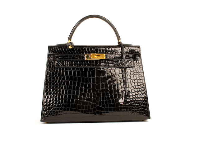 An Hermès black patent crocodile Kelly bag, 1999