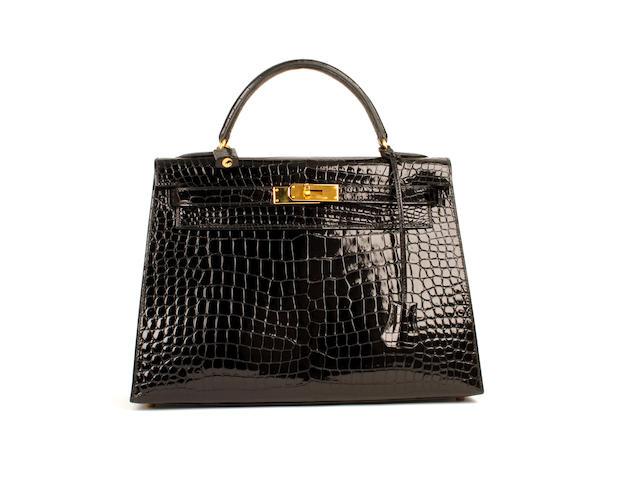 An Hermès black patent crocodile Kelly bag, 1999