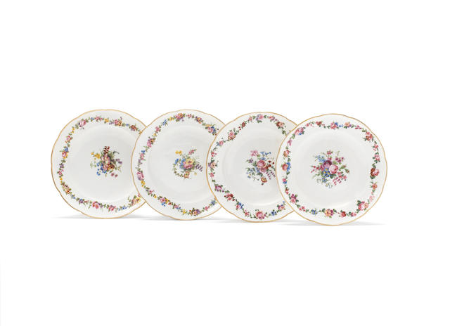 A set of four Sèvres plates, dated 1773 painted with flower festoons, with painter's marks of Pierre-Jean-Baptiste Vandé, Jean-Nicolas Le Bel and Michel-Gabriel Commelin