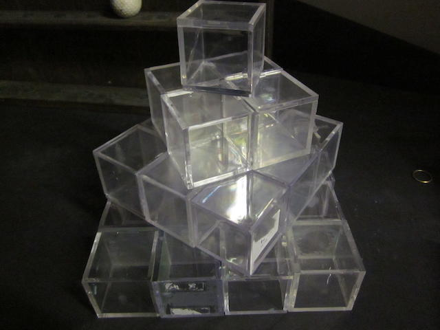A quantity of 60+ used Perspex golf ball cubes in good condition