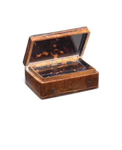 A fine and early Karalain birch and tortoiseshell musical snuffbox with gold and enamel crest, circa 1825,
