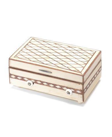 An early ivory and mahogany musical snuffbox, circa 1825,