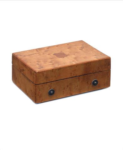 A bird's-eye maple musical snuffbox, circa 1860,