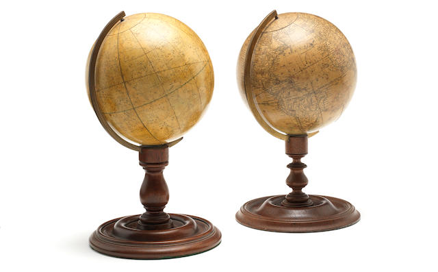 A matched pair of 6-inch Smiths terrestrial and celestial table globes,English, published 1864,