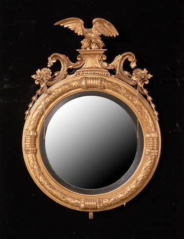A George IV and later giltwood convex mirror