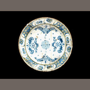 An Iznik dish with blue floral design