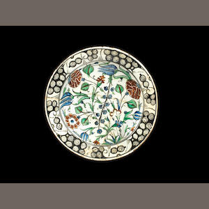 A large Iznik bowl with red carnations