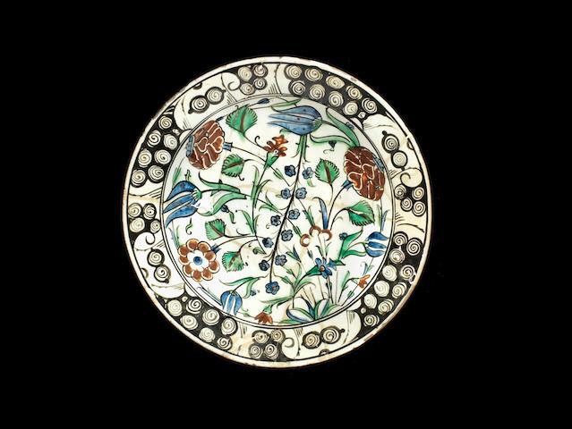 An Iznik 'Storm in a teacup' design pottery Bowl Turkey, 17th Century