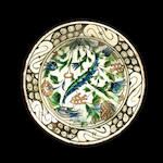 An Iznik bowl with red tulips, saz leaf