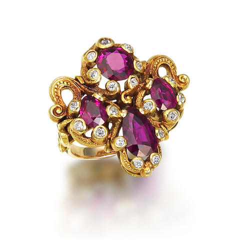 An art nouveau ruby and diamond cluster ring, attributed to Marcus & Co,