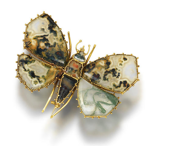 A gold and moss agate butterfly brooch,