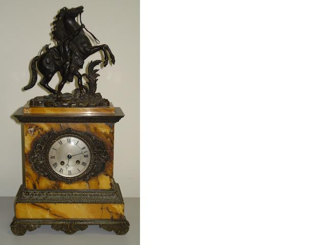 A 19th Century French bronze and sienna marble mantel clock