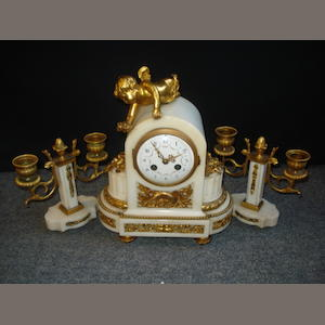 An early 20th Century mantel clock and garniture