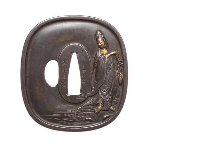 A late iron tsuba 19th century