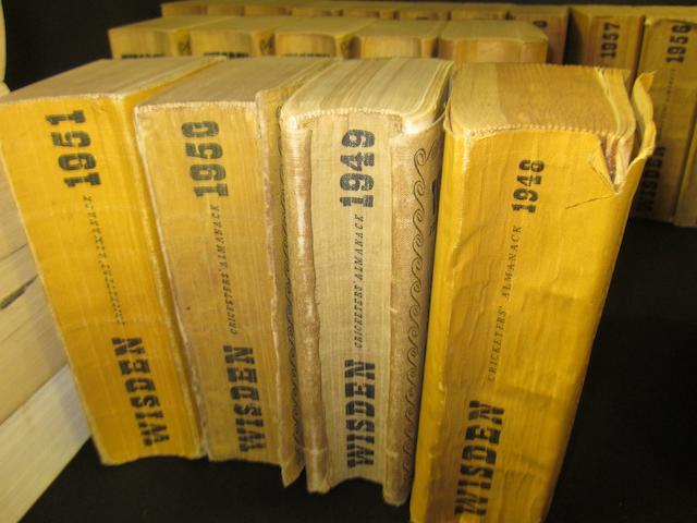 A collection of Wisdens cricket almanacks 1948-2002