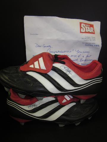 A pair of David Beckham hand signed football boots