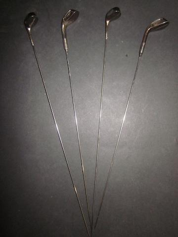 Four  Victorian silver hat pins in the shape of long nose golf clubs