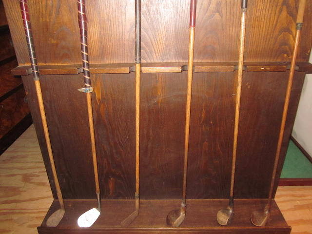 A collection of 8 wooden shafted clubs