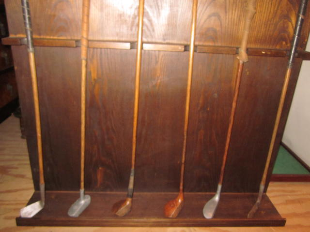 A golf bag with 8 clubs - wooden shafts.