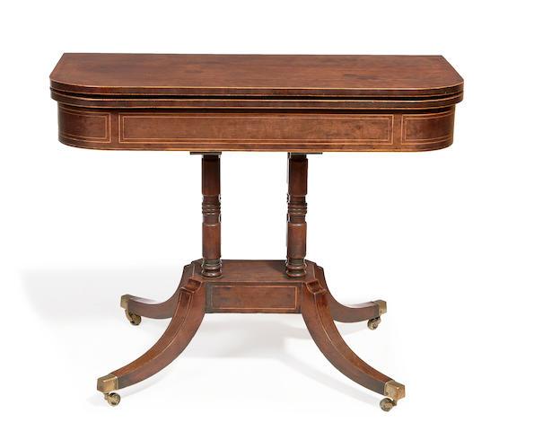 A Regency mahogany D-shaped pedestal tea table