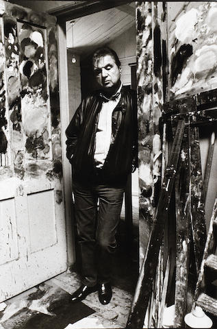 Bruce Bernard (British, 1928-2000) Francis Bacon in the studio doorway, 1983 Paper 59.5 x 43.7cm (23 7/16in x 17 3/16in), image 49.2 x 33.5cm (19 3/8 x 13 3/16in).