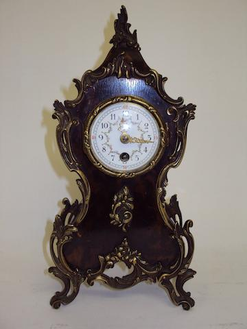 A late 19th century French simulated tortoishell mantel clock