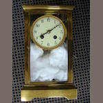 An early 20th Century brass four glass mantle clock,20cm high