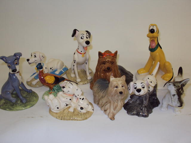 A collection of Royal Doulton and Beswick dog figurines