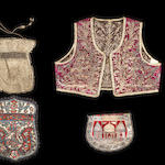 Three ottoman purses and a child's vest 19th century