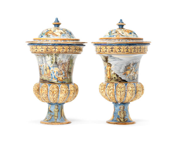 A fine pair of Castelli maiolica campana vases and covers, circa 1740