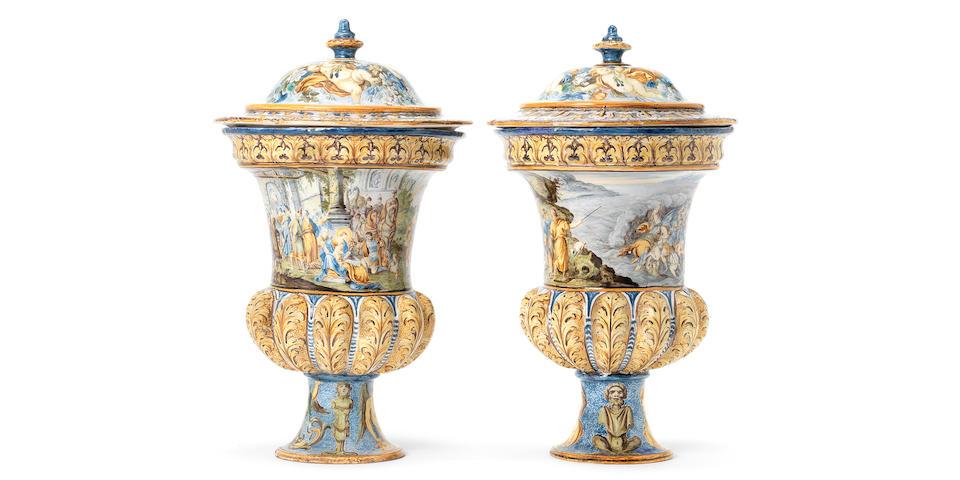 A fine pair of Castelli maiolica campana vases and covers, circa 1740